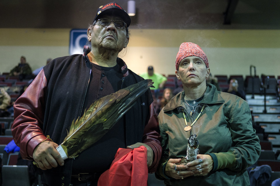 U.S. Army veterans Aloysious Bell, left, and Tie Kobolson, hold ceremonial feathers and a smudge stick during a forgiveness ceremony for veterans at the Four Prairie Knights Casino & Resort on the Standing Rock Sioux Reservation on Monday, Dec. 5, 2016.