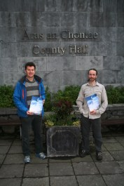 Kieran Cunnane and Bernard McGlinchey of Transition Galway dropping in a copy of 'A Vision for Galway 2030' into the Chief Executive of Galway County Council at County Hall.