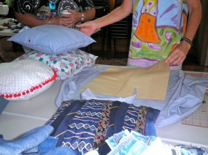 Cushion covers from old shirts - Positioning the pattern over the shirt front to line up the button opening.
