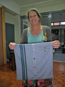 Making a cushion cover from an old shirt - the finished product looking great. Love the coloured buttons, how effective!