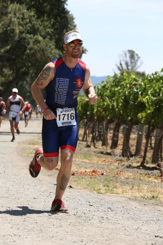 Running through the LA Crema Vineyard at Ironman 70.3 Vineman