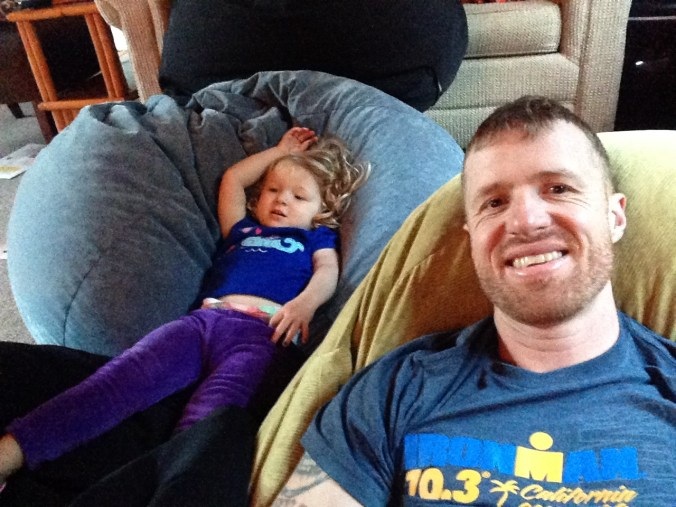 Sitting in bean bag chairs with my daughter after the race.