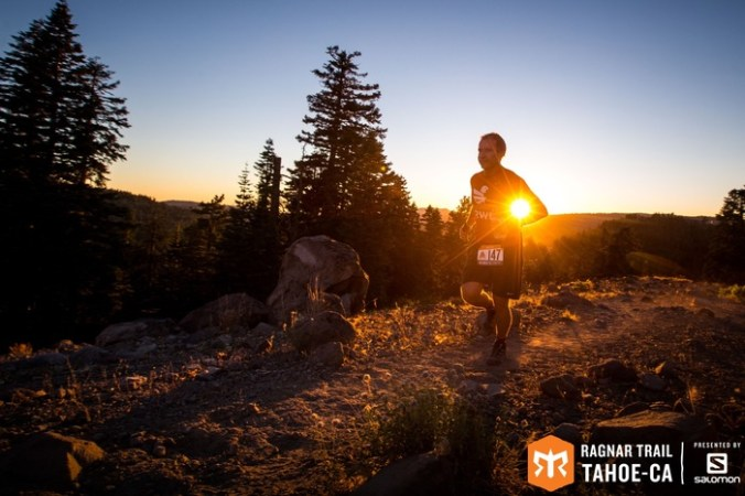 Runner on the yellow loop trail during sunrise for Ragnar Trail Tahoe.