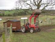 mobile-chicken-house-towed-by-tractor