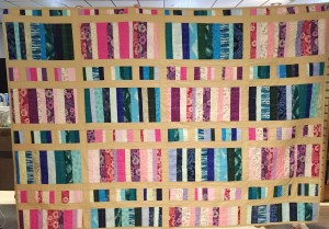 Handmade quilt to be raffled at the book sale.
