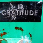 gratitude sign and rusty wall