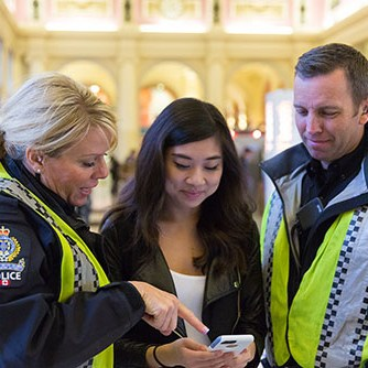 Transit Police Officers helping Passenger with OnDuty App