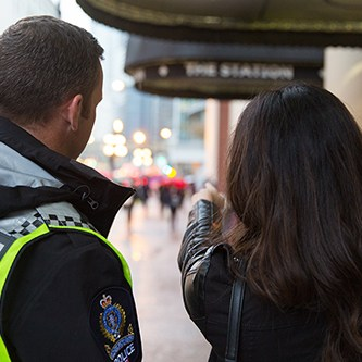 Passenger Pointing out Problem to Transit Police Officer