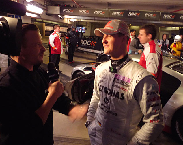 Neil has an on-camera chat with Michael Schumacher