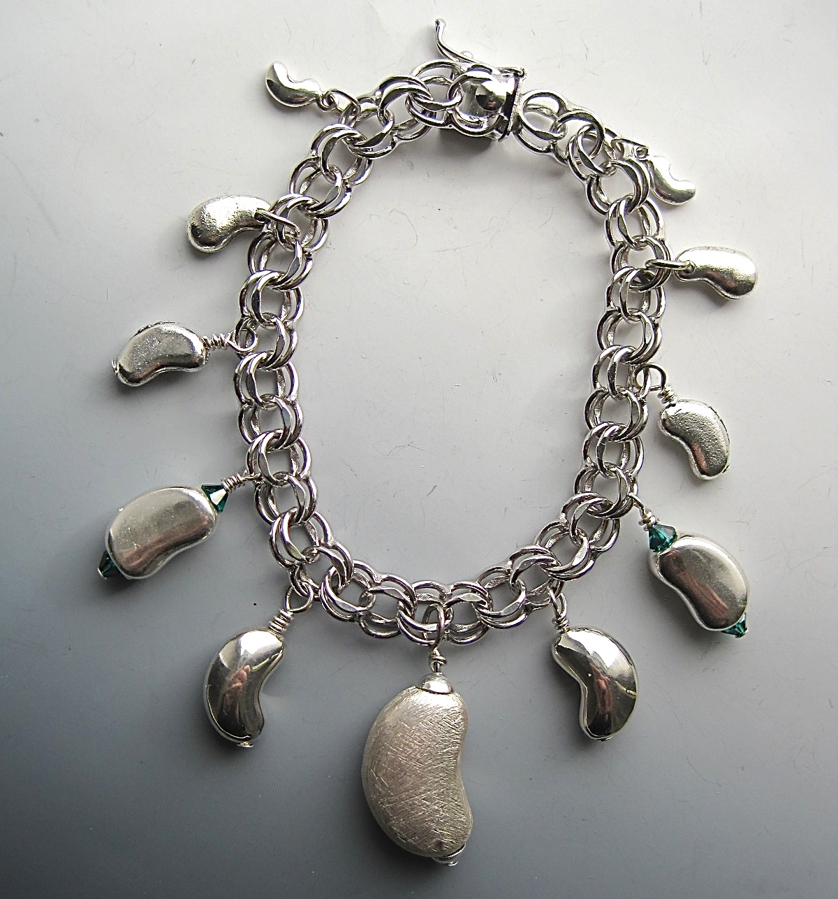 One Of A Kind Sterling And Pewter Kidney Charm Bracelet 1