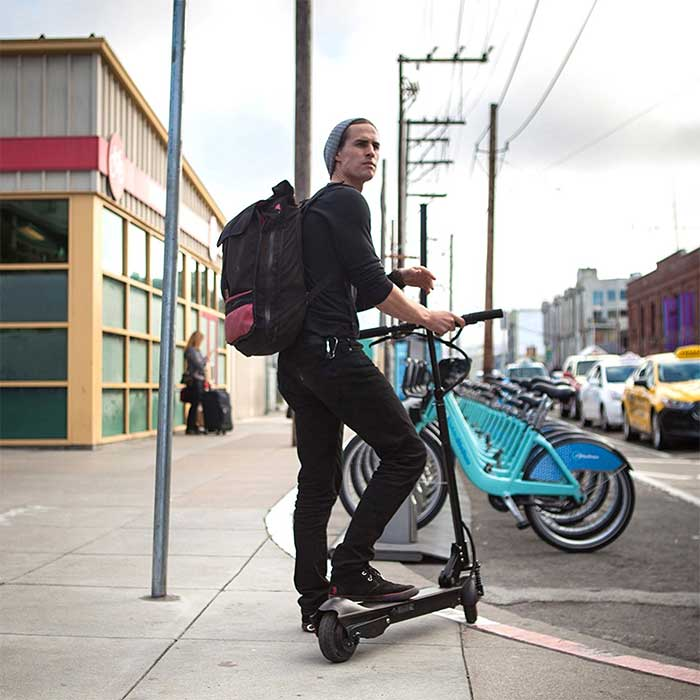 Adult Riding A Electric Scooter Downtown