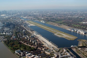 The runway at London City, bordered by the O2 and the Docklands. Note the residential areas nearby.