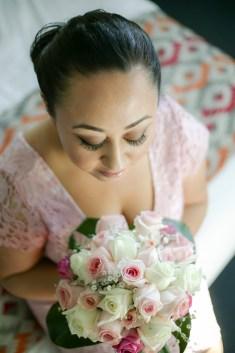 Sydney wedding bride looks down at her beautiful bouquet