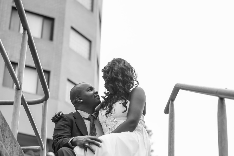 African australian sydney wedding couple look at each other