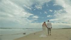 Australian sydney wedding couple walking on the sand