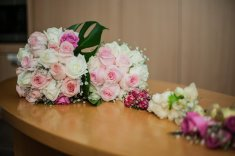 Australian kiwi bride has her bouquet laid out on the table