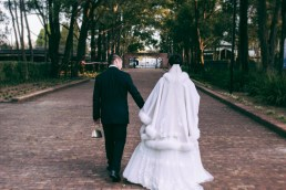 Australian sydney wedding couple walk at auburn botanic gardens