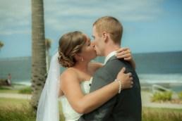 Australian wedding couple kiss on Australia day at cronulla