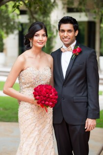 Beautiful indian bride and groom smiling at camera at curzon hall