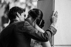 Black and white photo of indian wedding couple kissing