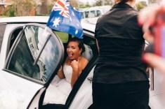 australian bride thumbs up at wedding photographer