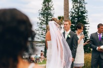 the bride and groom gaze at each other during wedding ceremony