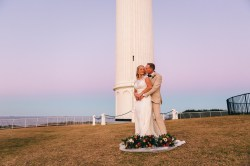 bride and groom at wollongong lighthouse wedding portrait