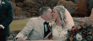 Emma & Dallas beautiful bride and groom kissing at ceremony rhodedendron gardens