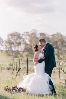 beautiful bride and groom in hunter valley vineyard portrait