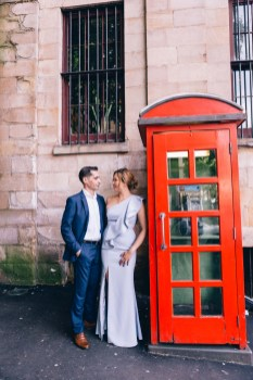 beautiful bride and groom at the rocks sydney next to red telephone booth