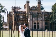 Hungarian bride and assyrian groom kissing at royal botanical gardens