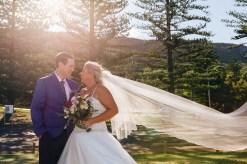 Australian Groom smiling at his beautiful bride