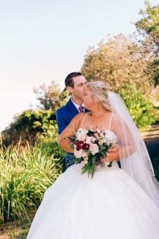 Australian Groom kissing his beautiful bride