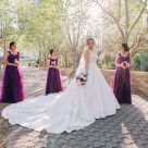 Beautiful bridesmaids look at the bride at Bicentennial Park Homebush Sydney_12