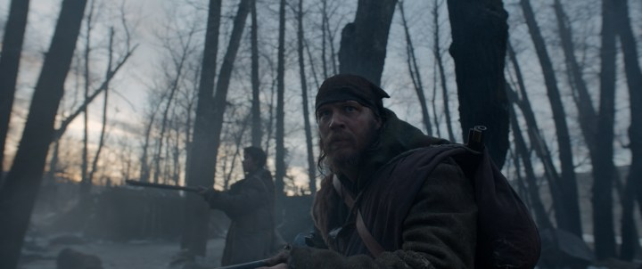 Tom Hardy (foreground) and Will Poulter hunt for the person they had left for dead, in THE REVENANT. Photo Credit: Courtesy Twentieth Century Fox. Copyright © 2015 Twentieth Century Fox Film Corporation. All rights reserved. THE REVENANT Motion Picture Copyright © 2015 Regency Entertainment (USA), Inc. and Monarchy Enterprises S.a.r.l. All rights reserved. Not for sale or duplication.