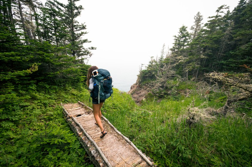 Hiker with solar lamp attached to backpack