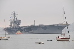 ...and watching an aircraft carrier leave port.