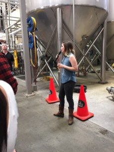 Naturally, the tour guide at Stone Brewery needs IPA to keep the vocal cords supple...