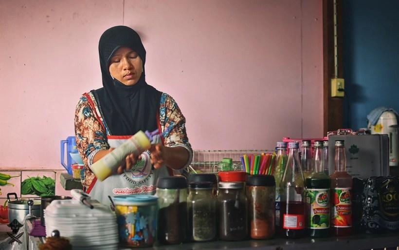 muslim woman from thai restaurant in Thailand Phuket Island is preparing a morning cofee