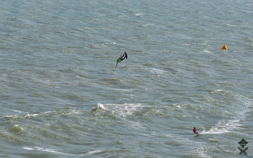 kitesurfer doing one handed table top trick during kitesurfing competition in Mui Ne Vietnam 2018