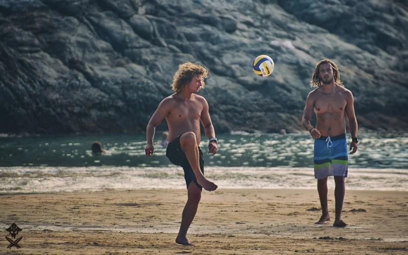 kitesurf instructors are playing football during no wind days at the Nai Harn beach in Phuket Island Thailand 2018