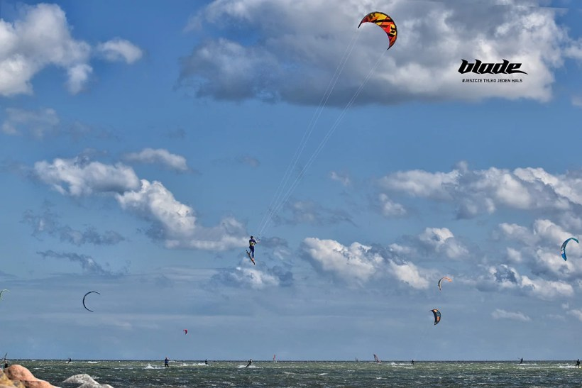 kitesurfer making a big jump with tail grab in the best kitesurfing spot in Poland Hel Chalupy6