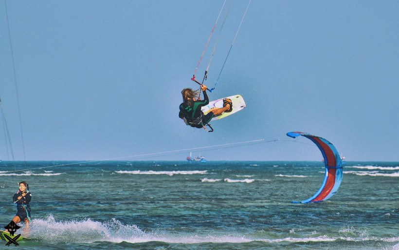 kitesurfer doing a tail grab front roll on the Phan Rang lagoon best kite spot in Vietnam