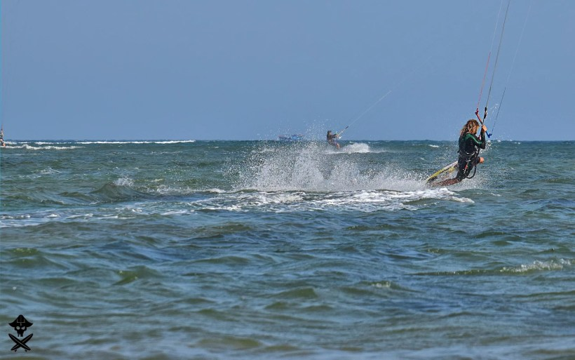 kitesurfer Michal Karski is doing stylish dark slide trick on the Phan Rang lagoon best kitesurfing spot in Vietnam