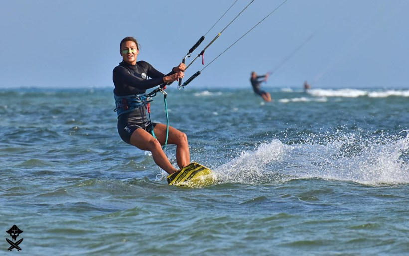 Ania is edging a kite board on the Phan Rang lagoon one of the best kitesurfing spots in Vietnam