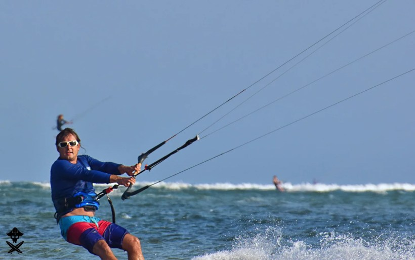 funny picture of two kitesurfers one in the front and second one farther in Phan RAng