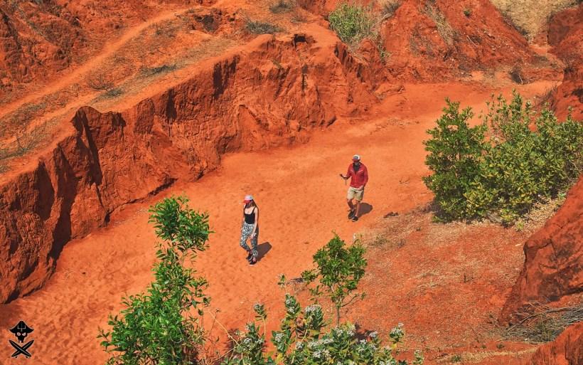 couple walking in unbelievable red canyon Mui Ne Vietnam