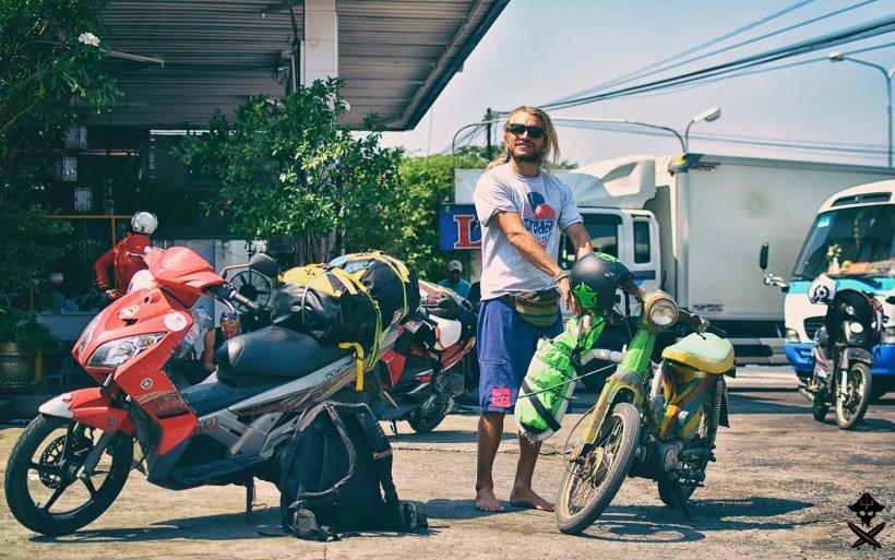 Karaś is refueling his old rasta bike during the motorbike trip from Mui Ne to Phan Rang