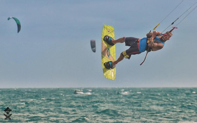 lenny german kitesurfing instructor is doing stylish backroll with powerful kiteloop at Mui Ne beach vietnam
