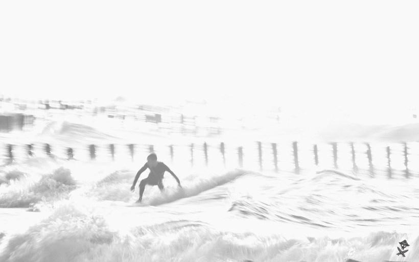 czarno białe zdjęcie surfer polska bałtyk chałupy